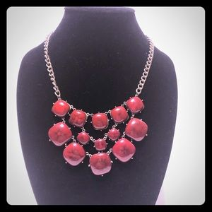 Gold toned and red necklace